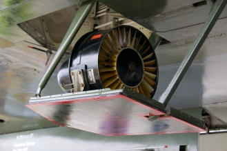 This is an emergency air-powered generator. In the event the four main engines and the back-up turbine failed this small unit could be deployed to create enough electricity to keep the onboard systems functioning long enough for the crew to be able to maintain control of the aircraft whilst they prepared for their escape via ejector seat or parachute jump out of the main hatch.